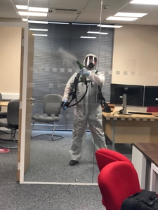 Sanitising the office glass due to Covid-19